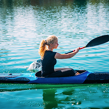 woman on a lake kayaking